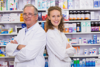 pharmacists posing inside pharmacy