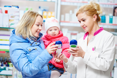 a mom and daughter buying product